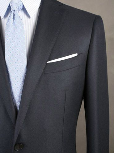 西服穿着得体的评判标准是什么?